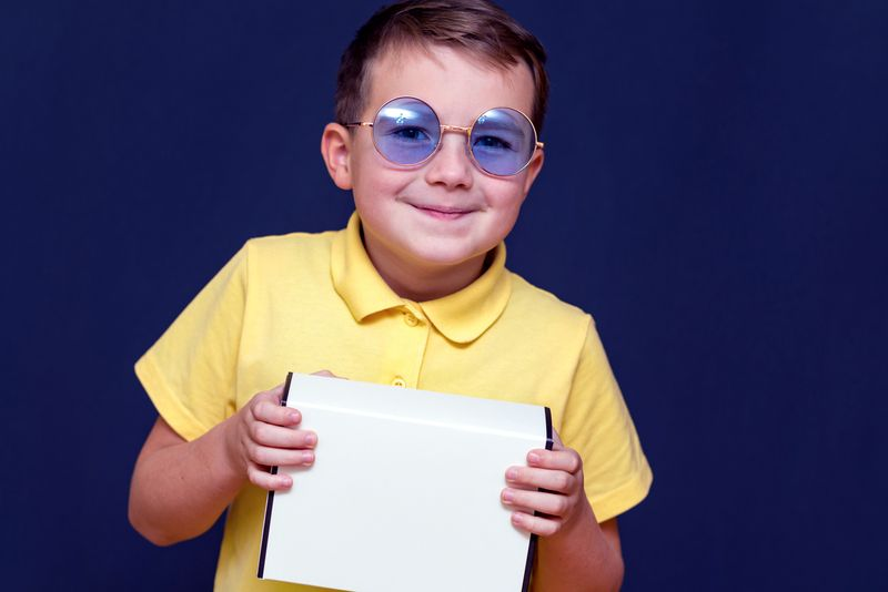 boy with color blindness correction glasses